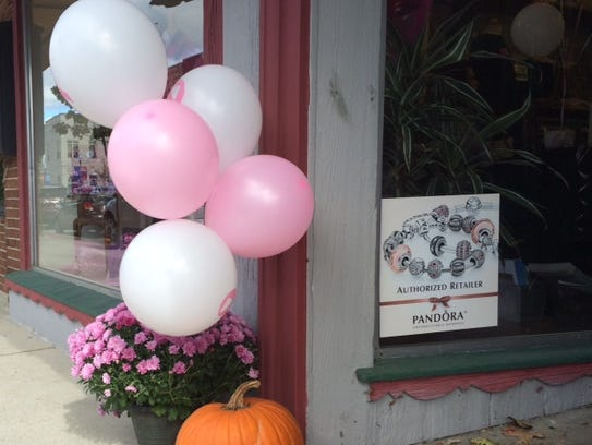 Pink and white balloons greet visitors to Wilkins &