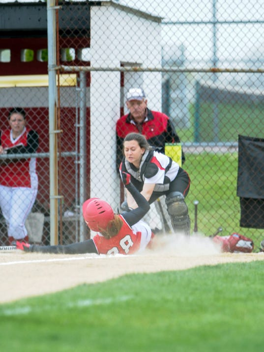 Pequea Valley's Lydia Cacciola slides in safely at home under the tag of Annville-Cleona catcher Amber Rexrode during Friday's Section Four showdown in Annville. Cacciola scored the game's lone run in a 1-0 victory that tied Pequea Valley with A-C for first place in the section with one game remaining.