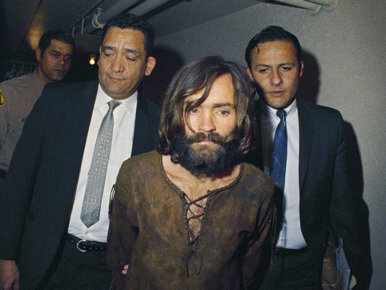 FILE - In this 1969 file photo, Charles Manson is escorted