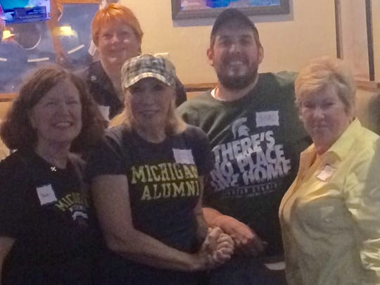 Sports columnist Shad Powers, wearing his Michigan State green in a sea of maize and blue Michigan fans on Saturday at the Beer Hunter in La Quinta.