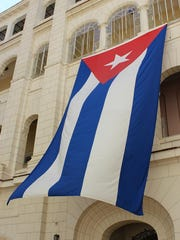 Cuban flag at the Museum of the Revolution, the former Presidential Palace, in Havana, Cuba.