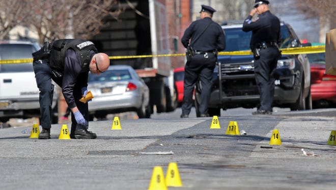 Police investigate a shooting in the 600 block of Jefferson St. in Wilmington on March 22. Mayoral candidates are scheduled to discuss public safety issues Thursday in a debate hosted by The News Journal, WHYY and several community groups.