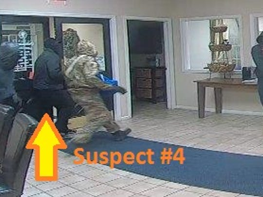 This Dec. 9, 2016 surveillance photo shows four of five suspects that robbed the Bank of Delmarva on Eastern Shore Drive in Salisbury. One suspect is in custody.