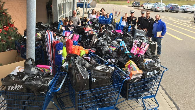 HBA of Greater Lansing and community members shopped to buy gifts for Toys for Tots.