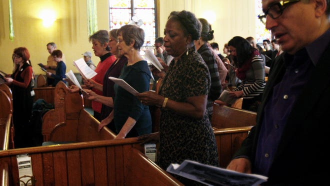 The congregation at LaSalle Street Church in Chicago, shown on Sunday, Nov. 2, 2014, does everything from feeding homeless families to buying an ambulance for a medical clinic in Niger. The non-denominational congregation is racially and economically diverse: More than 60% of members have advanced degrees; about a third live paycheck-to-paycheck. Retiree Jeliner Jordan, 71, second from right, used her $500 to help schools and the arts and to help her granddaughter pay off her student loans from college.