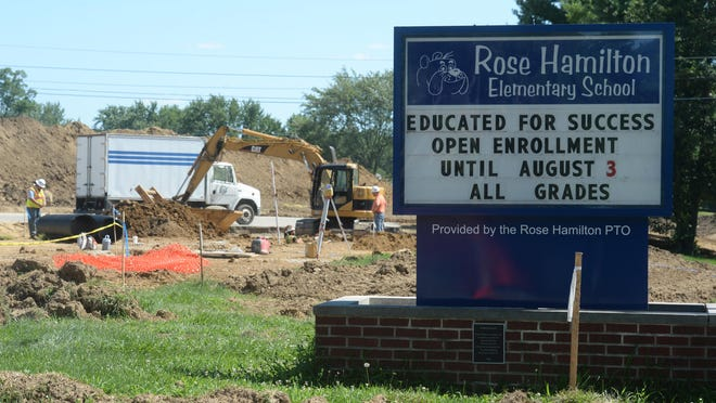 Parking lot and driveway construction continues Thursday at Rose Hamilton Elementary School in Centerville.