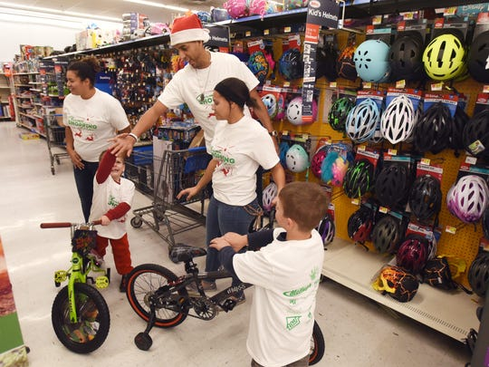 Kevin Martin gets a high five from Mikey James, 5, after James picked out a bike at Walmart on Wednesday.