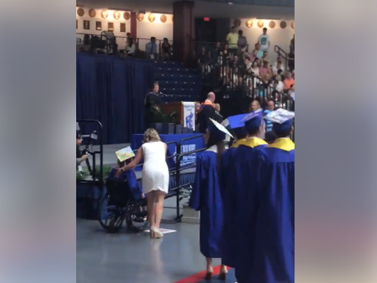 Blake Portmann shared a video saying her sister, Lili, was not allowed to ride her wheelchair up the ramp and accept her high school diploma onstage.