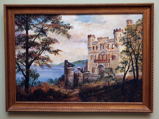 Paintings of Bannerman Castle and Island line the walls