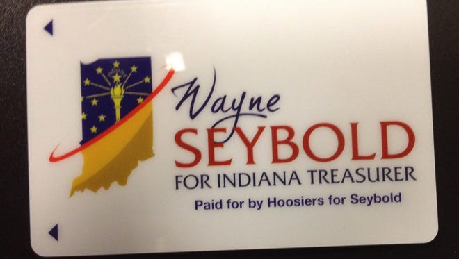 Former Olympic skater and Marion Mayor Wayne Seybold plastered his bid for state treasurer on the convention's hotel key cards.