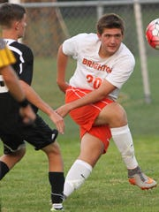 Brighton's Tanner Spires moves the ball downfield against Stephen Rowley of Plymouth.