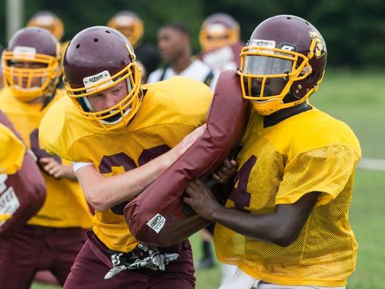 Two Washington High School football players collide