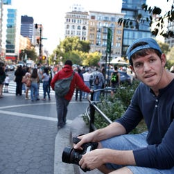 This Oct. 2, 2013, file photo shows street portrait photographer Brandon Stanton, creator of the popular Humans of New York blog, near Union Square in New York.