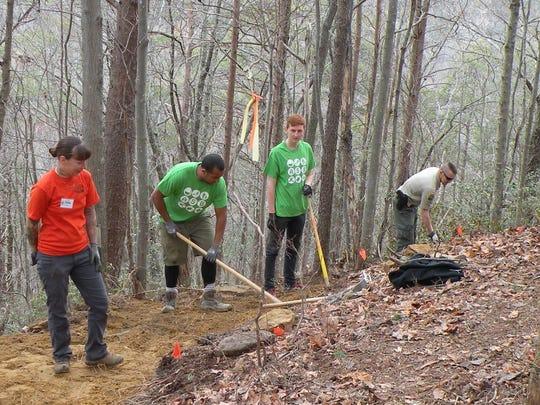 Shauna Anschuetz, left, supervises work on the Cumberland Trail near Sale Creek.