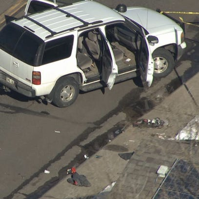 A kidnapping and robbery suspect who was shot by Aurora