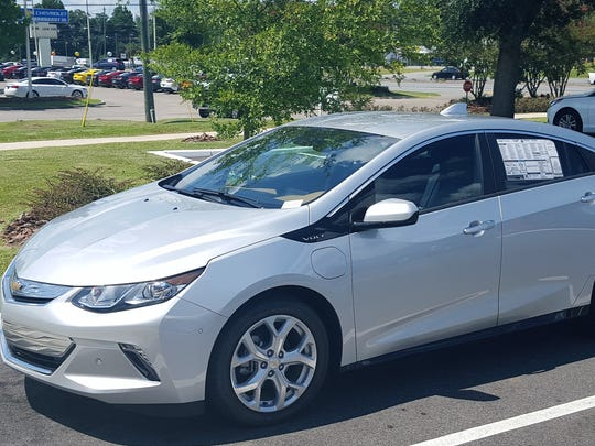 The Volt is sporty, large enough for a family of four, and runs mostly on electric power.