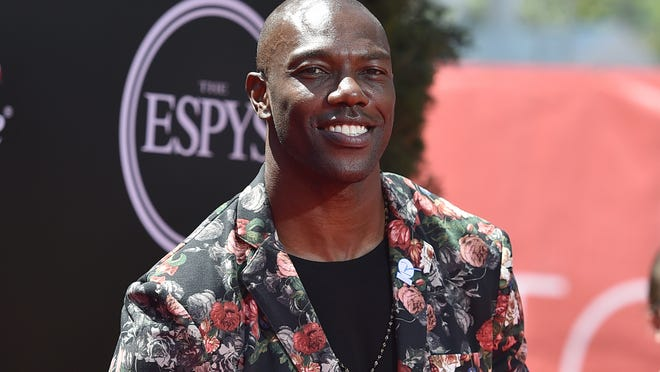 """FILE - In this July 13, 2016, file photo, former NFL player Terrell Owens arrives at the ESPY Awards at the Microsoft Theater in Los Angeles. Terrell Owens says he will not attend the induction ceremony for the Pro Football Hall of Fame in August, an unprecedented decision by an enshrinee. Owens was voted into the hall in February. In a statement released Thursday, June 7, 2018, by his publicist, Owens says: """"While I am incredibly appreciative of this opportunity, I have made the decision to publicly decline my invitation to attend the induction ceremony in Canton.""""(Photo by Jordan Strauss/Invision/AP)"""