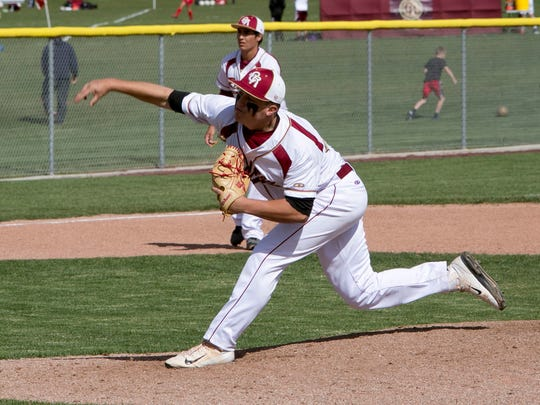 Cedar High pitcher Brecken Lewis throws against Hurricane
