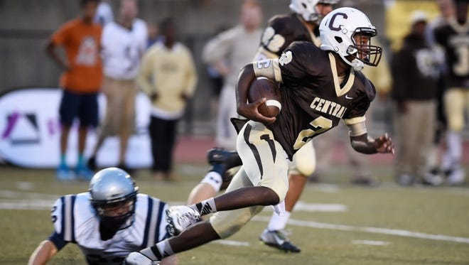Central's Tias Stewart breaks a tackle as he returns a kickoff for a first-half touchdown against Reitz at Central Stadium, September 11, 2015.