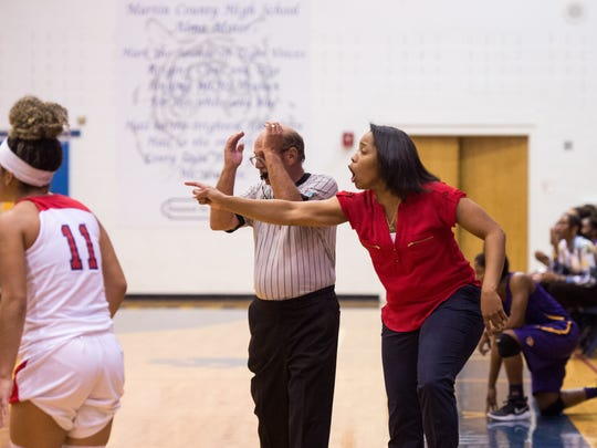 Jamarra Robinson (right) has guided St. Lucie West Centennial High School's girls basketball team to a 33-15 record in two seasons. The Eagles are one win from their first regional final since 2002.