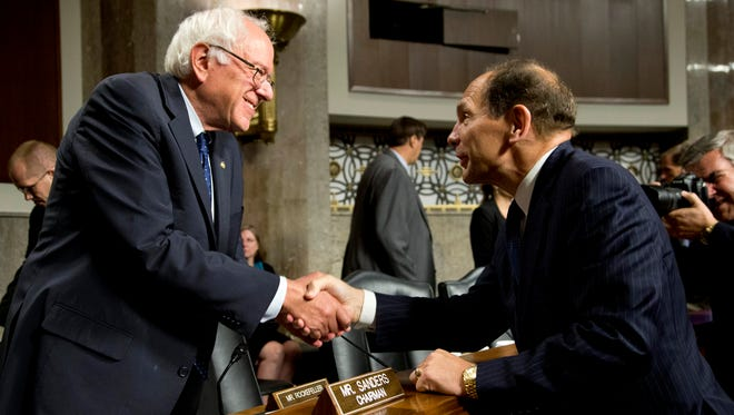 Veterans Affairs Secretary nominee Robert McDonald, right, shakes hands with  Senate Veterans' Affairs Committee Chairman Bernard Sanders, I-Vt., at the conclusion of the committee's hearings to examine his nomination to be Secretary of Veterans Affairs on Capitol Hill in Washington, Tuesday, July 22, 2014.