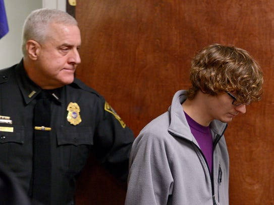 Christopher Leonard, right, appears in court to give