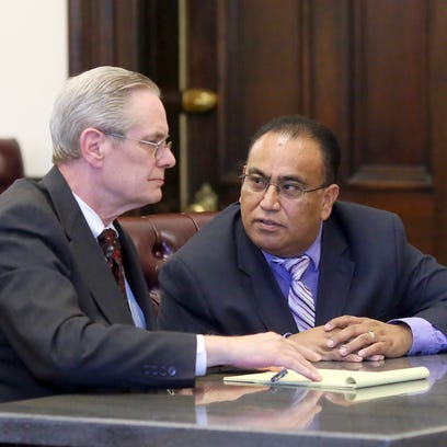Dr. David Velasquez, right, who stood trial in Coshocton