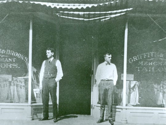 N. W. Brooks, left, and A. W. Griffith in front of their tailor shop, probably 107 E. Beverley Street, probably 1920s.