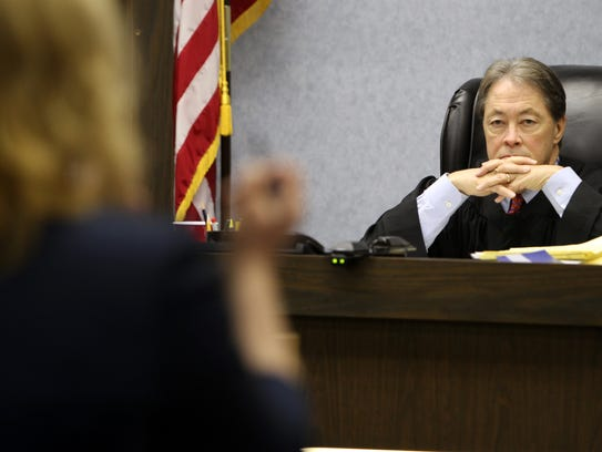 Campbell Circuit Judge Fred A. Stine listens in a May