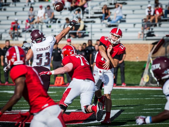 Ball State's Riley Neal passes past Eastern Kentucky's