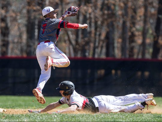 Jackson Liberty vs Jackson Memorial baseball. Memorial's Kyle Thaiss slides in safe at second base at Liberty's Alex Torres tries to catch a high throw. Jackson, NJSaturday, April 8, 2017@dhoodhood