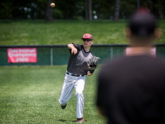 Wapahani's Alec Summers throws during practice at Wapahani