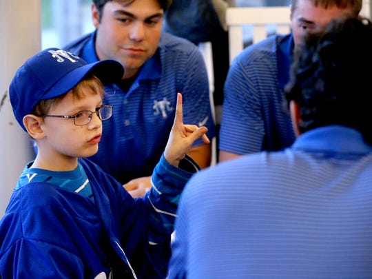 Luke Denson, 9, who has Schwachman-Diamond Syndrome, signed a letter of intent with the MTSU baseball team during a signing ceremony held at MTSU's Kennon Sports Hall of Fame Building, on Thursday Nov. 6, 2014. Denson was paired up with MTSU baseball through Team IMPACT.