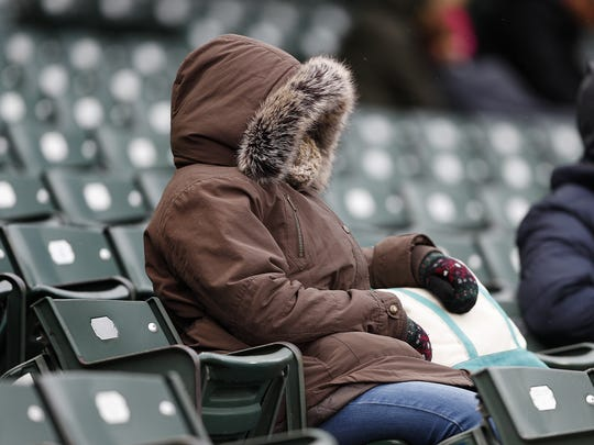 Indianapolis Indians fans attempt to stay warm before