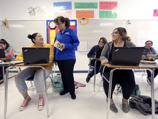 Clint Early College High School math teacher Carlota Alvarez Basurto jokes with a student in class Wednesday. The Council on Regional Economic Expansion and Educational Development, or CREEED, announced it had awarded $259,000 in scholarships for teachers to receive their dual-credit credentials.