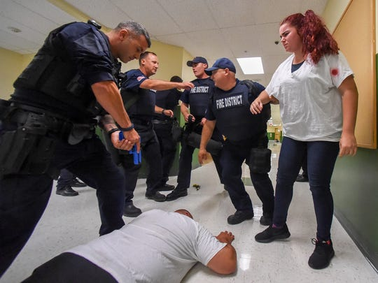 """Port St. Lucie Police Officers and St. Lucie County Fire Rescue conduct """"active threat"""" and S.A.V.E. (Swift Assisted Victim Extraction) training Wednesday, July 11, 2018, at Renaissance Charter School of St. Lucie in Port St. Lucie."""