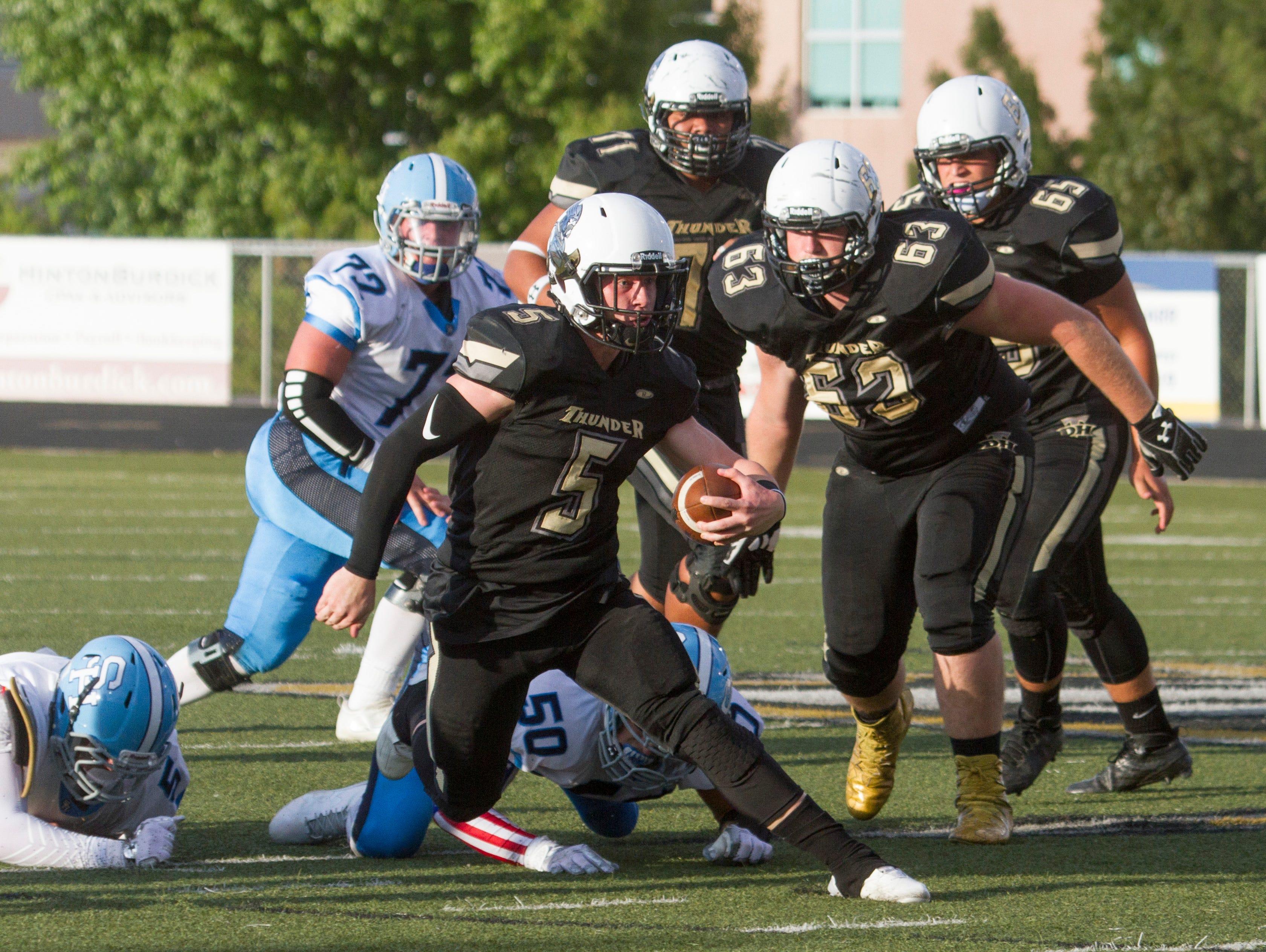 Desert Hills High School football defeats Salem Hills 28-7 Friday, August 26, 2016.