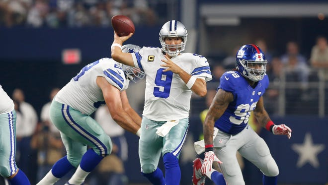 Cowboys quarterback Tony Romo (9) throws in the pocket against the New York Giants at AT&T Stadium.