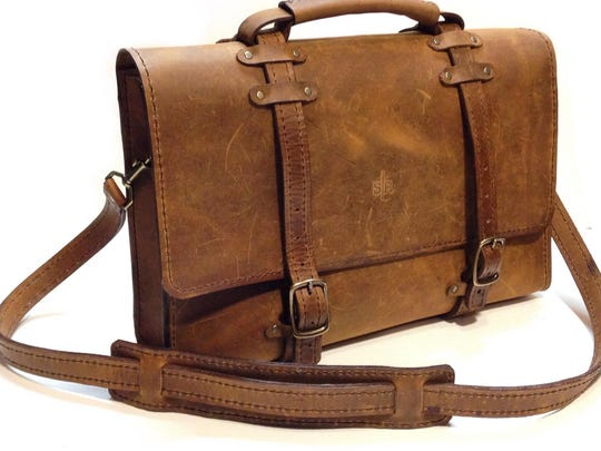 Jason Hooge carries a variety of leather products, including bags.