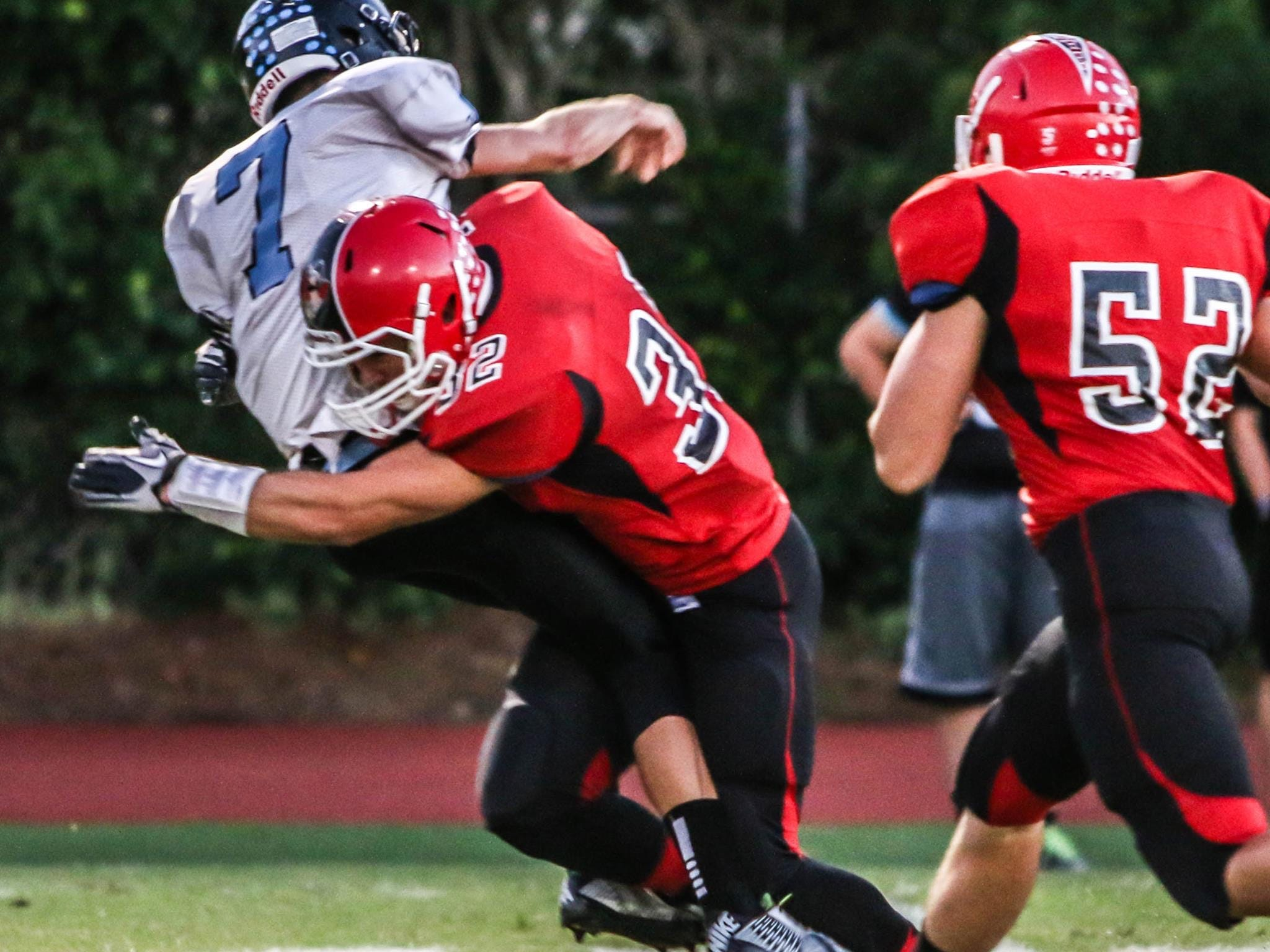 Evangelical Christian School senior linebacker Carson Pearlman makes a tackle in a game last fall.