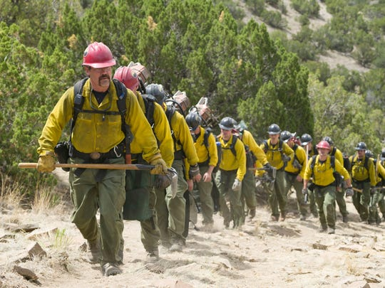 "Eric Marsh (Josh Brolin, front) leads the Granite Mountain Hotshots up the trail at Yarnell Hill in Columbia Pictures' ""Only the Brave."" The film, based on the 2013 deaths of Arizona's Granite Mountain Hotshots, was filmed in New Mexico."
