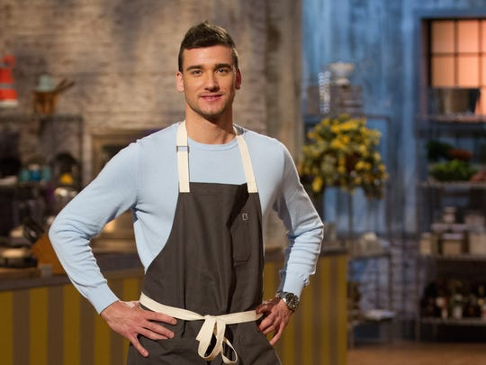 "Damiano Carrara, co-owner of Carrara Pastries in Moorpark, poses on the set of the Food Network show ""Spring Baking Championship."" He has since gone on to serve as a judge for other Food Network competitions — and to open the Carrara Kitchen cooking school."