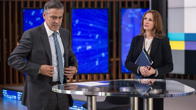 """George Clooney, left, and Julia Roberts appear in a scene from """"Money Monster."""""""