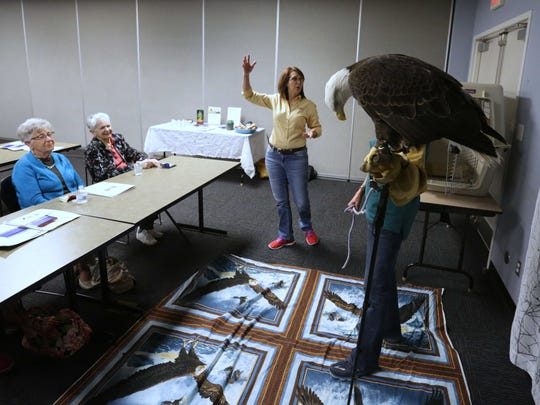 Phoenix the Eagle from the Dickerson Park Zoo visits the Healing Path Class. Pam Price, left, the zoo's Conservation Education Co-Ordinator, talks about her.