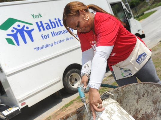 Melanie Still was one of the volunteers working on a York Habitat for Humanity construction site in Windsor during the National Women Build Week on Thursday, May 8, 2014. Jason Plotkin - Daily Record/Sunday News