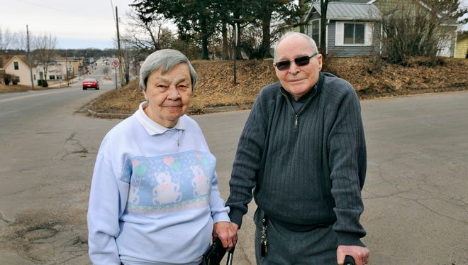 Tom and Clara Hyslop stand outside their home Wednesday in Sauk Rapids. They will soon be moving and their house will removed to make room for the widening of Second Street.