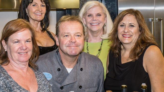 Event committee -Kathy Schriefer, Ellen Spencer, Ellen Woods and Lisa Wherry surrounding Chef Andrew Copley.