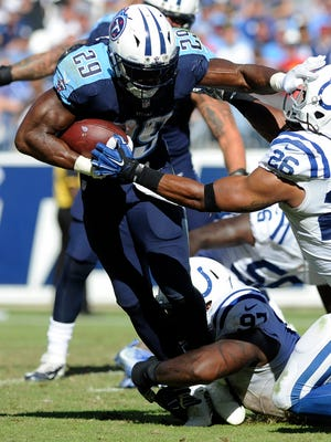 Titans running back DeMarco Murray (29) stiff arms Colts free safety Clayton Geathers (26) in the fourth quarter at Nissan Stadium Sunday, Oct. 23, 2016, in Nashville, Tenn.