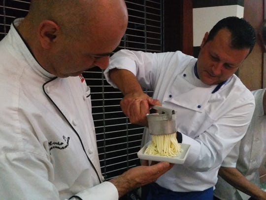 "Gelato chef Rudi Sacchet grinds spaghetti-style Gelato onto a plate held by chef Mirko Di Giacomantonio. Today, the Centre of Tallahassee mall announced a new food concept called the ""Urban Food Market."" It will feature four Italian-themed restaurants under one roof."