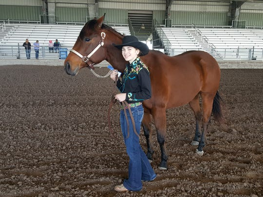 Trinity O'Brien and her American quarter horse Brandy walk back to the pens of the San Patricio County Fairgrounds arena after winning the first place blue ribbon in the showmanship portion of the horse show at the 2017 San Patricio & Aransas Counties Agricultural & Homemakers Show.